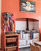 A collection of rosettes adorn a pinboard in a country kitchen