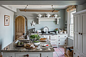 Fresh food on kitchen island in restored 16th century farmhouse
