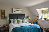 Double bed with wooden headboard in bedroom