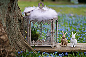 Easter bunny and grape hyacinths in the glass shrine and Easter bunnies on wooden board