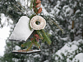 Small bird feeder with a homemade bird seed ring