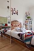 Floor-to-ceiling mirror and wooden bed in girl's bedroom room