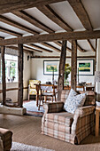 Rustic living room with wooden beams, watercolours on the wall