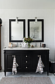 Black vanity unit with double washbasin and two wall mirrors