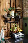 Vintage kitchen utensils against rustic wooden wall