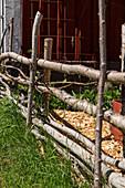 DIY garden fence made of branches