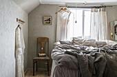 Rural bedroom in grey tones