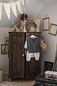 Old wardrobe and baby clothes in the children's room
