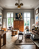Classic beige living room with stucco ceiling in period building