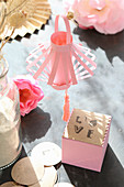 Pink paper lantern and cube labelled 'Love' in sunshine