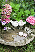 Birdbath made from cast concrete rhubarb leaf