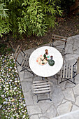 View down onto terrace with round table and chairs