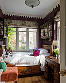 Antique wooden bed in small, English-style child's bedroom