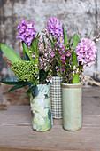 Vases of hyacinths, skimmia, waxflowers and broom