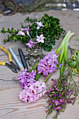 Materials for spring wreath: hyacinths, waxflowers, mimosa, box, florists' wire and wire cutters