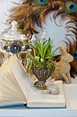 Easter arrangement of grape hyacinths, Easter bunny and wreath of feathers