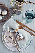 Gold coloured Easter eggs with 'Happy Eastern' writing as plate decoration