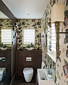 Elegant guest WC with floral wallpaper and brown tiles