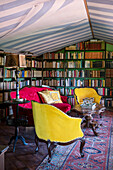 Antique upholstered armchairs and sofa in the library
