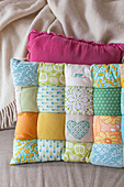 Handmade patchwork cushion in pastel shades