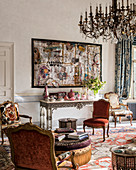 Collage above console table and Baroque chairs in living room