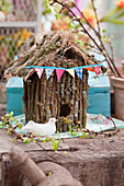 Ornamental bird nesting box made from twigs