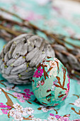 Easter eggs decorated with decoupage wrapping paper and willow catkins