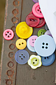 Colorful buttons on an old crate