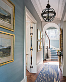 Elegant hallway in classic period building with pale blue walls