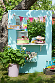 DIY play shop for children in garden