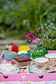 Handmade felt cakes and ice-cream and china teacups on tray