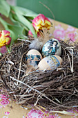 Decorated Easter eggs arranged in nest