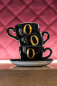 Black coffee cups with golden numbers