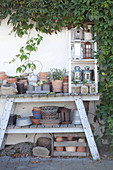 Plant pots, lanterns and bid nesting boxes on work table