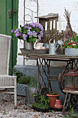 Vase of lilac on old sewing machine base decoratively arranged on terrace