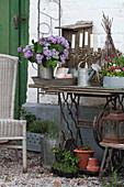 Vase of lilac on old sewing machine base decoratively arranged on terrace