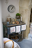 Wall clock above an old table with junk and flea market rounds