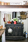 Antique kitchen oven in the alcove with an exhaust fan and nostalgic decor