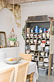 Old shelving unit with nostalgic crockery in a Mediterranean dining room