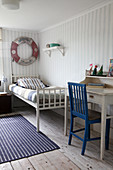 Various striped patters in maritime, vintage-style boy's bedroom