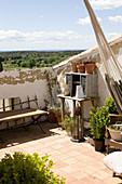 Mediterranean roof terrace with junk and view over the countryside