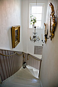 Rope handrails along staircase with wainscoting