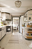 Country-house-style kitchen with white floor and grey accents