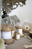 Thread spools and nostalgic objects in beige and white