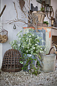 Wild carrots in a metal bucket and rustic objects as decoration