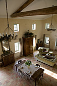 Open living room in French country house style with double room height