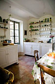 French-style country kitchen with terracotta tiled floor