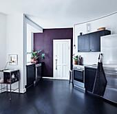 Contemporary kitchen with black linoleum floor