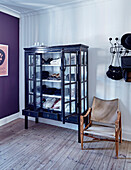 Classic chair next to display cabinet