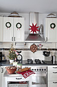 Country-house kitchen festively decorated with wreaths and star